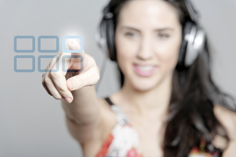 Woman selecting a song to listen to by pressing a concept button.jpeg