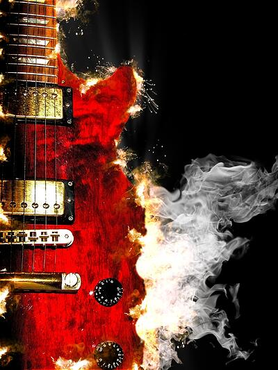 music concept with burn in fire and smoke design red electric guitar isolated on black background in dark.jpeg